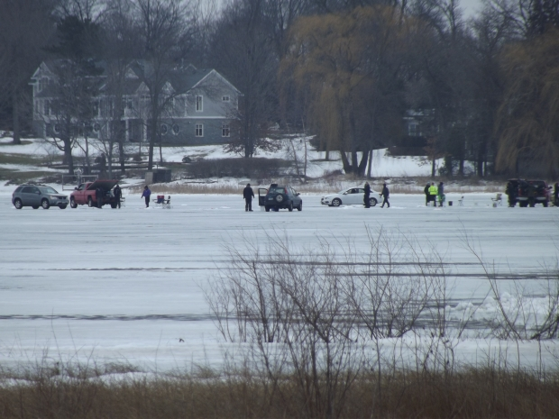 These people drove out on the lake so they could bring their gear and go ice fishing.